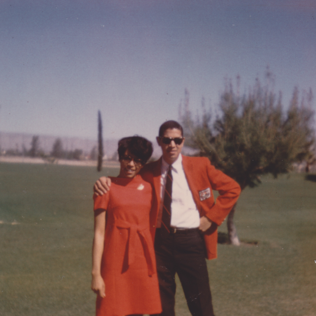 A photograph from the 1960s of a Black couple smiling happily.