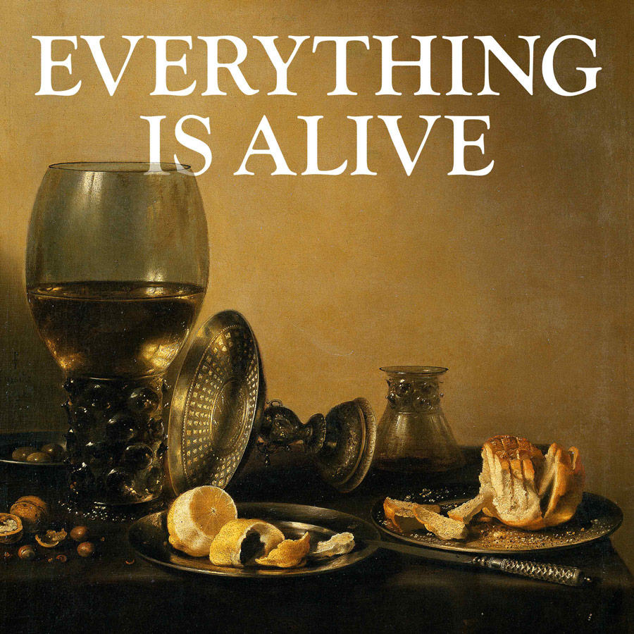 A still life showing a goblet of wine, a peeled clementine, and a loaf of sliced bread against a sepia backdrop, with the text: Everything is Alive.